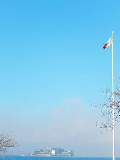 Clear Sky Blue Sky Flying Flag ItalianFlag Isolabella Foggy Morning Calm Water Walking Around Blue Sky Outdoors Nature Day Low Angle View Water No People Island Beauty In Nature Flags In The Wind  Beautifullisland Outdoorlover Breathing Space