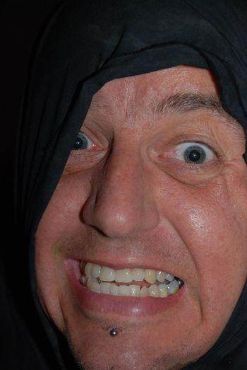 Close-up portrait of man making a face
