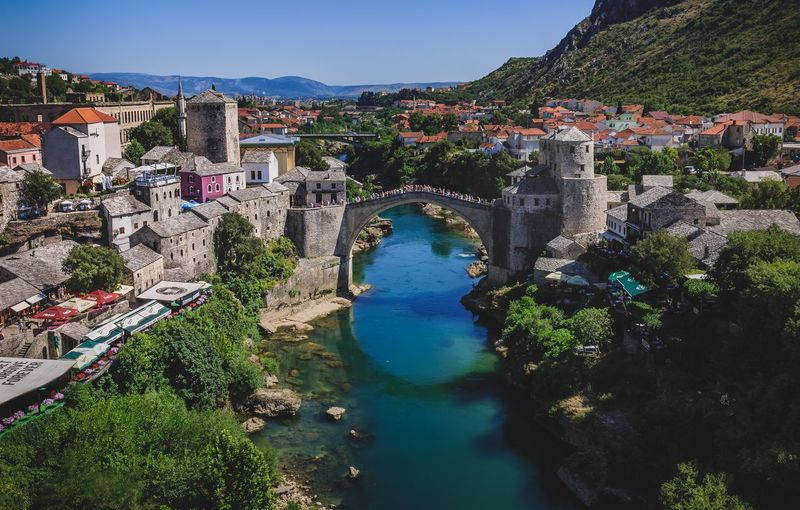 Old town Mostar Bosnia And Herzegovina Mostar Architecture Built Structure Water High Angle View Mountain River Arch Connection Bridge - Man Made Structure Tree Blue Building Exterior Outdoors Beauty In Nature Transportation Bridge Nature Sky