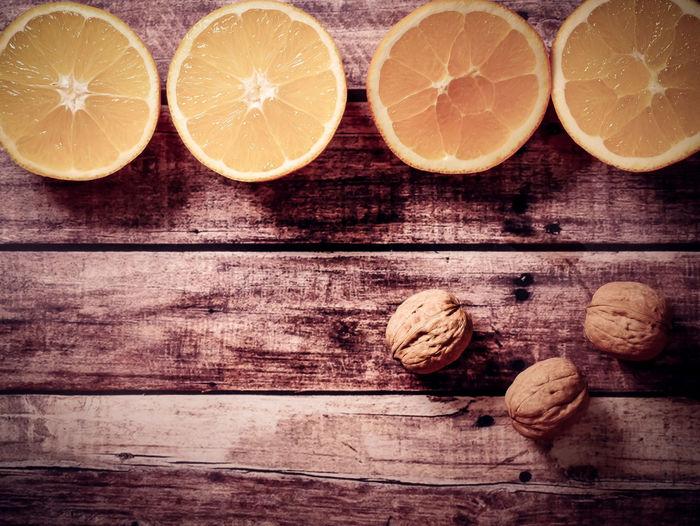 Wood - Material Food And Drink Citrus Fruit Fruit Healthy Eating Wellbeing Food Freshness SLICE Indoors  Table Orange - Fruit Orange Color Still Life No People Orange Cross Section Group Of Objects Lemon Close-up Sour Taste