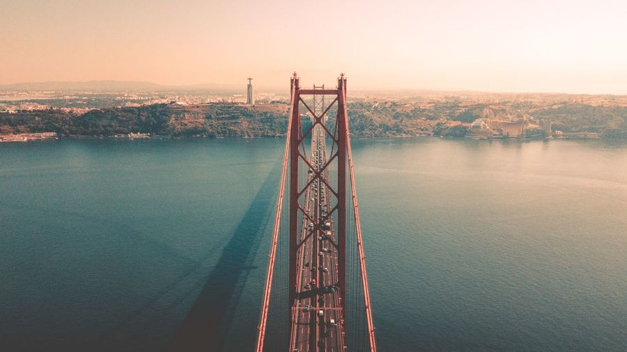 Ponte 25 de Abril, Bridge Panorama Landscape Landmark Wanderlust Germany Sky And Clouds Drone  Fromwhereidrone Beautiful Beautifuldestinations Wonderful Place Bucketlist Travel Destinations Nature Photography Water Sky Nature Sunset Beauty In Nature Tranquility Tranquil Scene Bridge Built Structure Outdoors Architecture Scenics - Nature No People Lake Bridge - Man Made Structure Connection