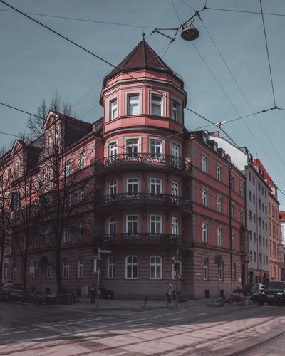 Building by street against sky