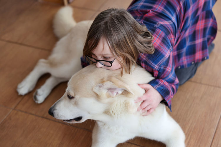 Low angle view of woman with dog on floor
