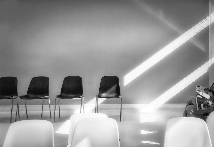 Low angle view of empty chairs