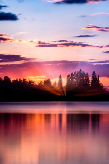 The last rays of the Sun Beauty In Nature Cloud - Sky Dramatic Sky Dusk Idyllic Lake Landscape Long Exposure Nature No People Orange Color Outdoors Reflection Romantic Sky Scenics Silhouette Sky Sunrise Sunset Sunset_collection Tranquil Scene Tranquility Tree Vacations Water