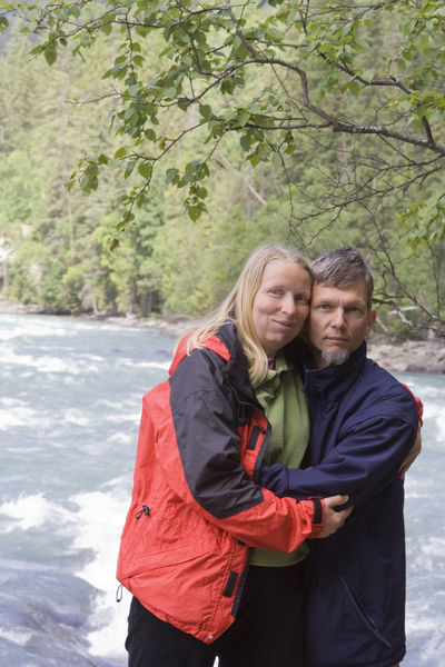 Couple in front of Fraser River - Rearguard Falls Provincial Park, Canadian Rockies, British Columbia Affectionate Blond Hair Bonding Canada Casual Clothing Caucasian Couple Couple - Relationship Embracing Front View Heterosexual Couple Hiking Love Mature Couple Mature Men Mature Women Nature Outdoors Real People River Romance Togetherness Two People Waist Up Water