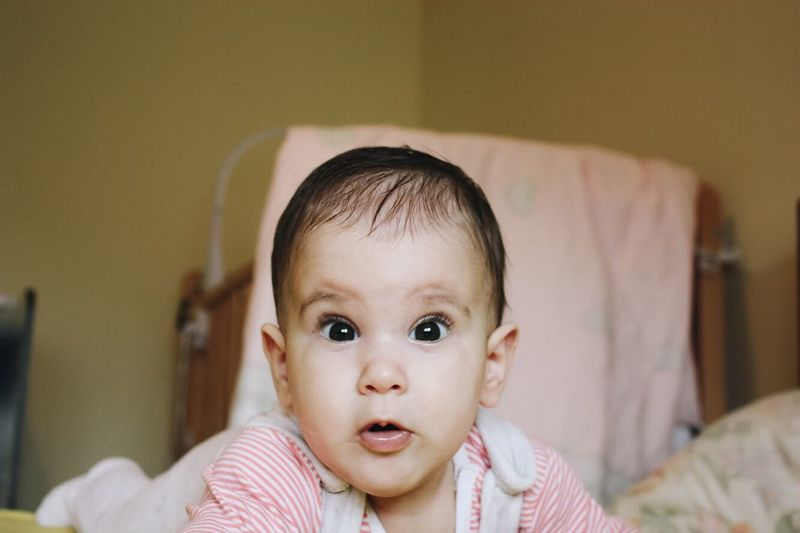 Baby Indoors  Cute Babyhood Innocence Looking At Camera Headshot One Person Portrait Focus On Foreground Babies Only Home Interior Front View Close-up People Bed Childhood Real People Toddler  Day