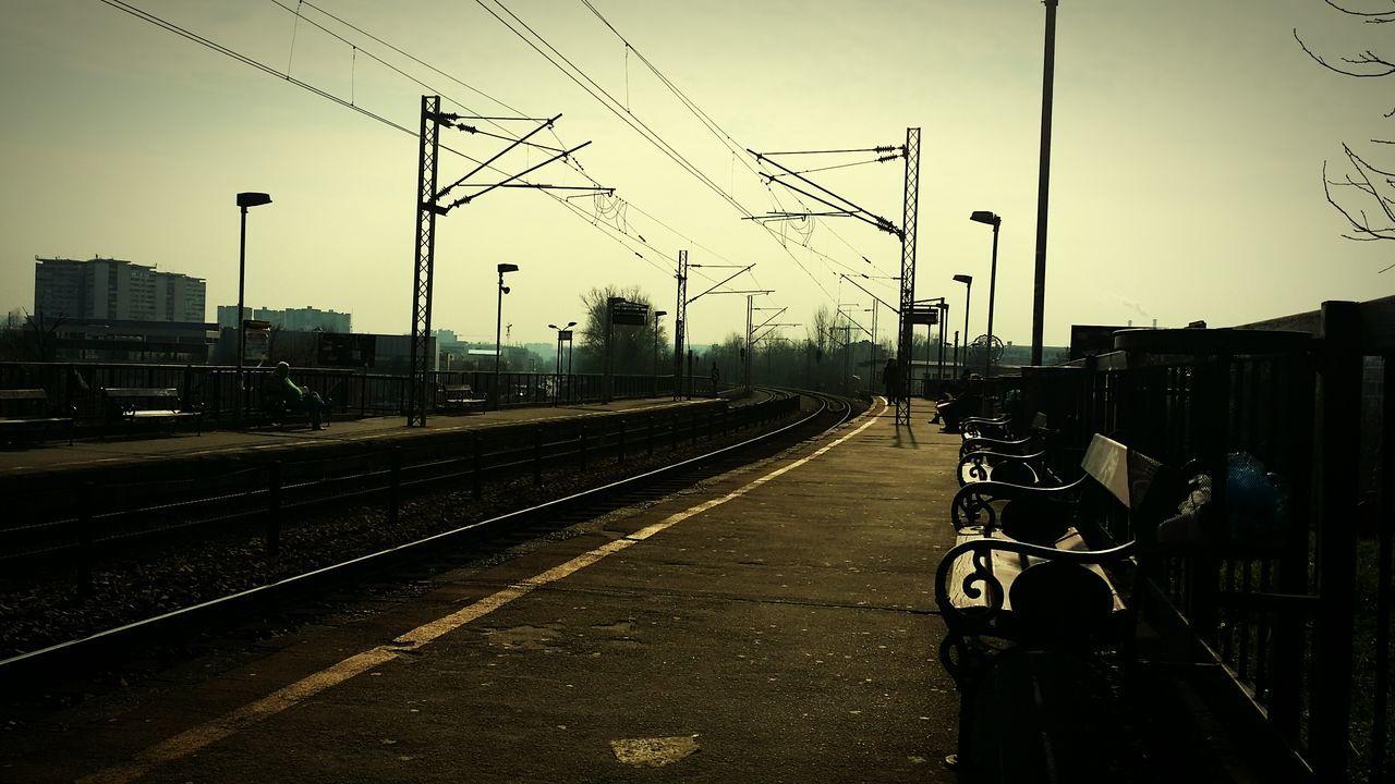 Empty Benches On Railroad Station Platform