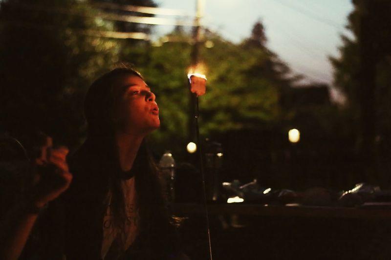Woman looking at illuminated light