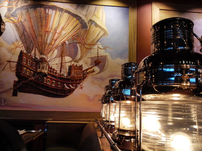 The evening in a cafe. Dirigible Airship Cafe Time Cafeteria Cafe Illuminated Arts Culture And Entertainment Film Industry Electric Light Light Bulb Bulb Energy Efficient Lightbulb Lamp Electric Bulb