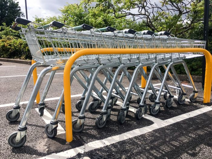 A Row Of Shopping Trolleys 🛒 First Eyeem Photo Outside Row LINE Groceries Grocery Shopping Cart Shopping Cart Supermarket Trollies Trolley Trolleys