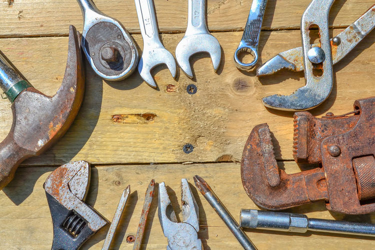 High angle view of tools on wooden table