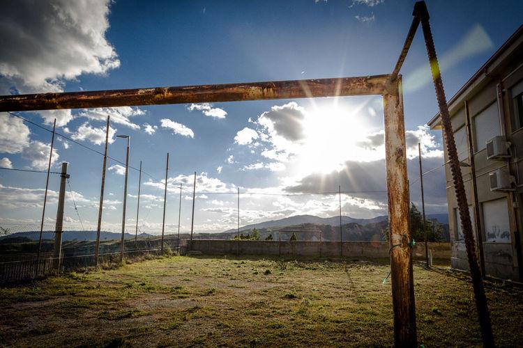 Scenic view of field against bright sun