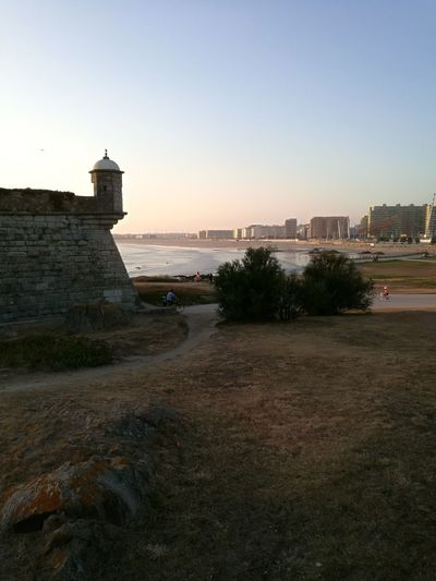 Castelo do Queijo, a ver as praias de Matosinhos. Architecture Built Structure Building Exterior Beach Travel Destinations Sunset Sky Outdoors Sea Water Day City Life Architecture Sunlight Porto Portugal Porto Portugal 🇵🇹 Beauty In Nature Tranquility City Grass Green Color Horizon Over Water