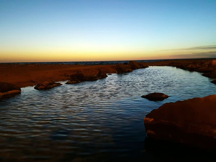 Sunset Sea Water Reflection Beauty In Nature Nature Scenics Rock - Object Outdoors Tranquil Scene Tranquility Coastline Beach Sunrise Morning Mood Morning Light Morning At The Beach Morning At The Sea