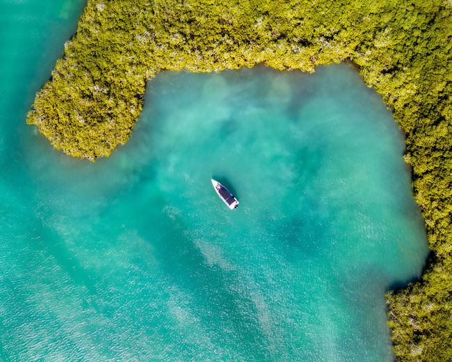 Aerial view of boat on sea during sunny day