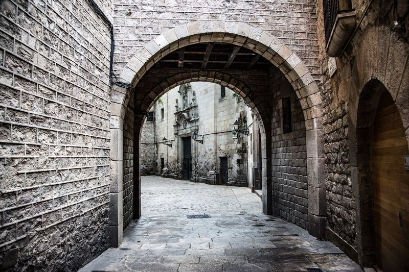 Simply Beautiful Castle Screensaver Gray Grey Barcelona Stone Wall Arch Architecture Built Structure Building Building Exterior No People Old History Wall The Way Forward Entrance Wall - Building Feature Door Gate Outdoors Corridor