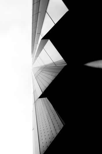 EyeEm Best Shots EyeEm Best Shots - Black + White A New Beginning Architecture Building Building Exterior Built Structure City Close-up Copy Space Dark Day Directly Below Geometric Shape Low Angle View Modern Nature No People Office Outdoors Pattern Sky Sunlight