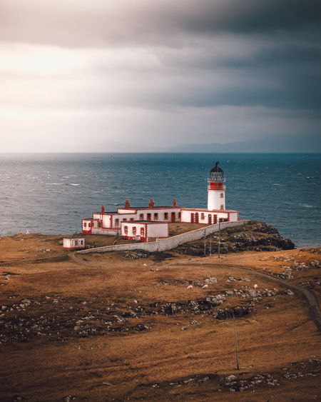 Neist Point Sea Water Sky Cloud - Sky Horizon Horizon Over Water Lighthouse Architecture Guidance Building Exterior Land Tower Beach Safety Protection Built Structure Nature Security Building No People Outdoors Isle Of Skye Neist Point Neist Point Lighthouse Scotland