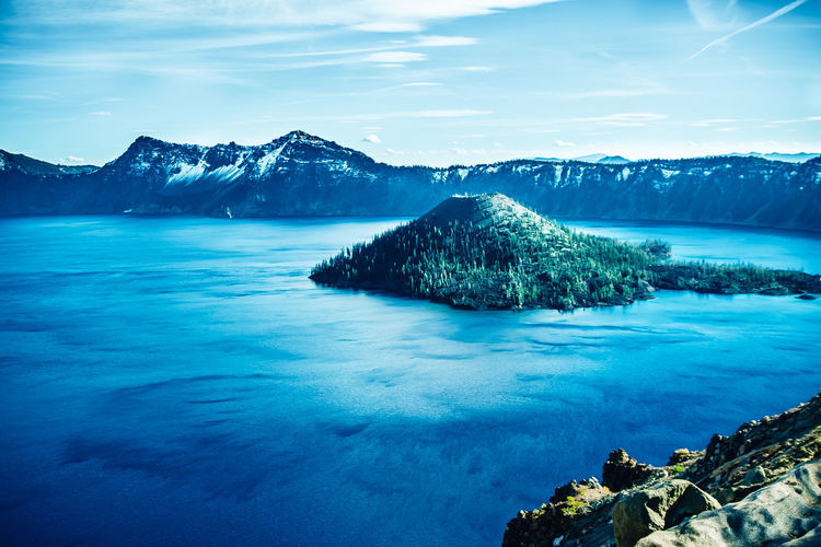 I have been to Crater Lake twice now. Once in Sep and another time in Oct. That one month really set it apart. In October it was well in its way into windy and cold winter. Friends who visited in Nov had no luck of view because of snow storm. Beauty In Nature Blue Cold Temperature Crater Lake Lake Landscape Mountain My Life My View National Park No People Oregon Outdoors Scenics Sky Snow Travel U.S.A Water Winter Wizard Island Wizard Island, Oregon, Crater Lake!