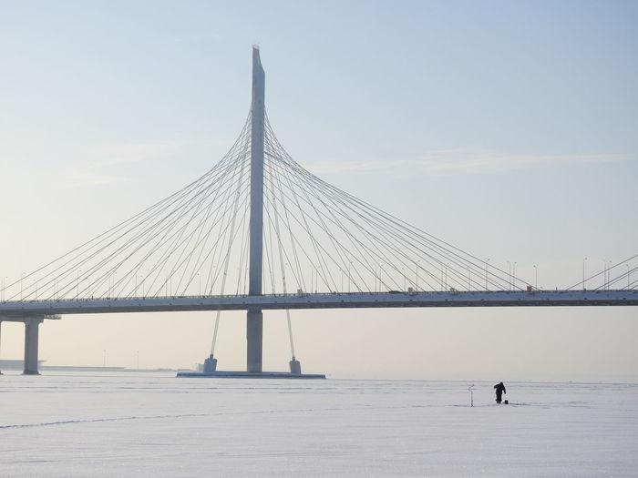 Suspension bridge against sky during winter