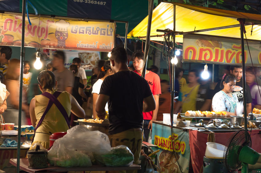 Thailand Nakhonpathom Close-up Outdoors Food And Drink Night Food Buddha Status Buddhist Popular Monk Big Brass Monk Status Lightning Men People Group Of People City Lifestyles Large Group Of People Women Real People Enjoyment Fun Yellow For Sale Shops