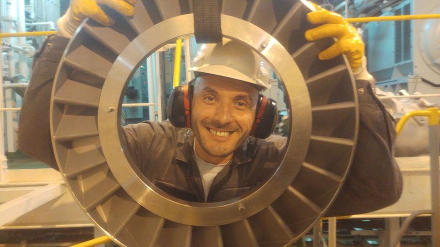 Working hard, happily! Marine #engineering #EngineRoom #ship Turbocharger EyeEm Selects Working Manufacturing Equipment Portrait Occupation Industry Factory Men Reflective Clothing Efficiency Headshot Turbine Steel Worker