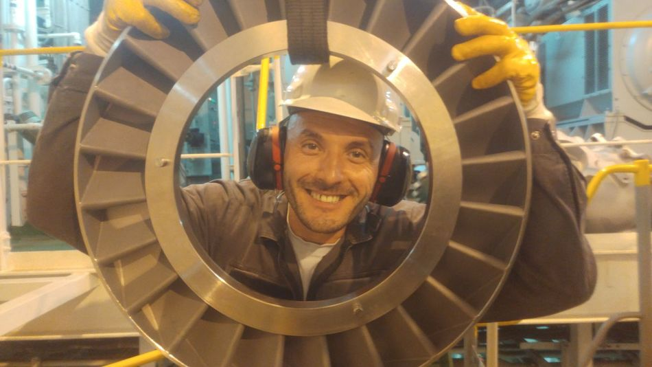 Working hard, happily! Marine #engineering #EngineRoom #ship Turbocharger EyeEm Selects Working Manufacturing Equipment Portrait Occupation Industry Factory Men Reflective Clothing Efficiency Headshot Turbine Steel Worker