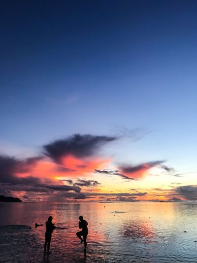 Tumon bay Sunset Guam Sky Sunset Beauty In Nature Scenics - Nature Sea Water Orange Color Beach Silhouette Tranquility Cloud - Sky Nature Two People Horizon Over Water