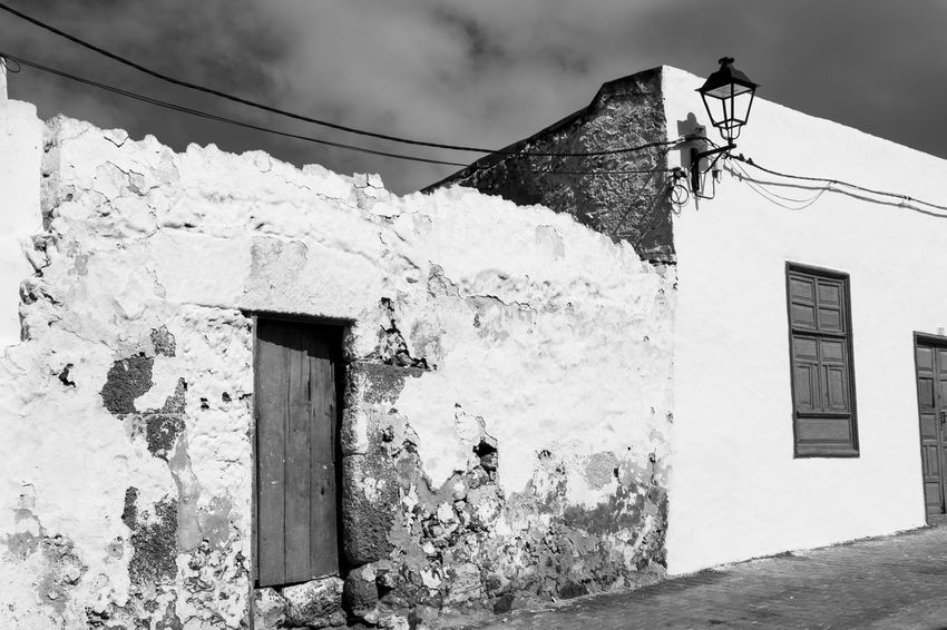 shabby house in Teguise, Lanzarote, Canary islands Ailing Condition Architecture Black & White Black And White Black And White Photography Building Exterior Built Structure Cable Canary Islands Day House Lamp Lanzarote Low Angle View No People Outdoors Residential Building Shabby Sky SPAIN Street Teguise