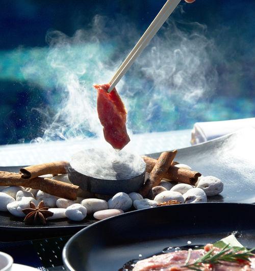 Close-up of food in chopsticks