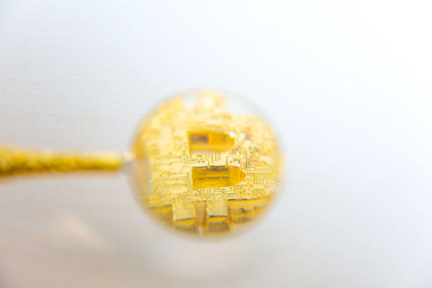 Studio Shot Yellow Indoors  No People White Background Single Object Close-up Gold Colored Business Finance Wealth Gold Jewelry Text Copy Space High Angle View Success Two Objects Economy Coin Luxury