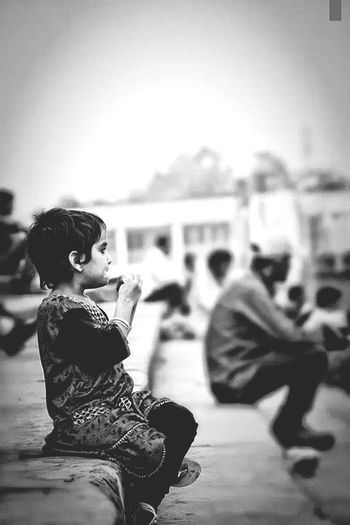 First let me finish my ice cream, then I can worry about where my mom is Littlegirl Lost Don Filter Streetphoto_bw