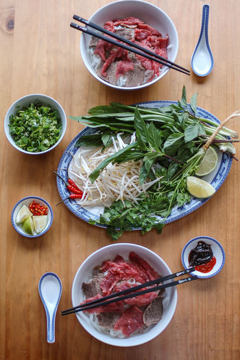 Bowl Cooking Cooking At Home Food Food And Drink Freshness Homemade Food Indoors  No People Table Vietnamese Food Vietnamese Pho Aromatic Herbs Coriander Bean Sprouts Beef