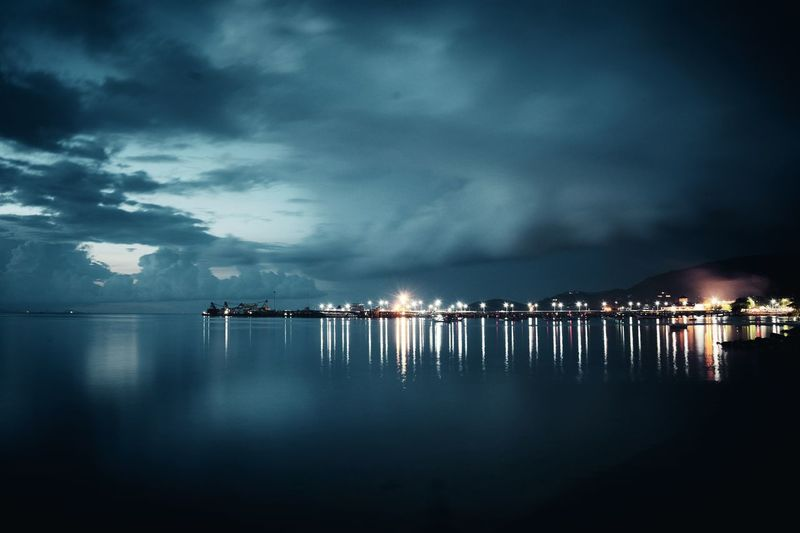 EyeEm Selects Night Sea Reflection Water Cloud - Sky Outdoors Sky Blue Illuminated Beach Harbor Vacations No People Beauty In Nature