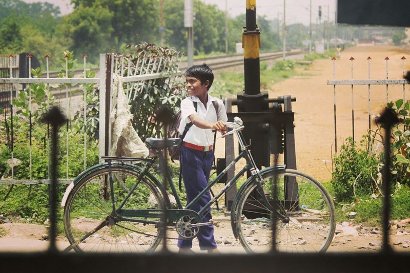 Little Boy Is Going To School Crossing Railway Track In Cycle Say Capture The Moment Looking Back To See Train