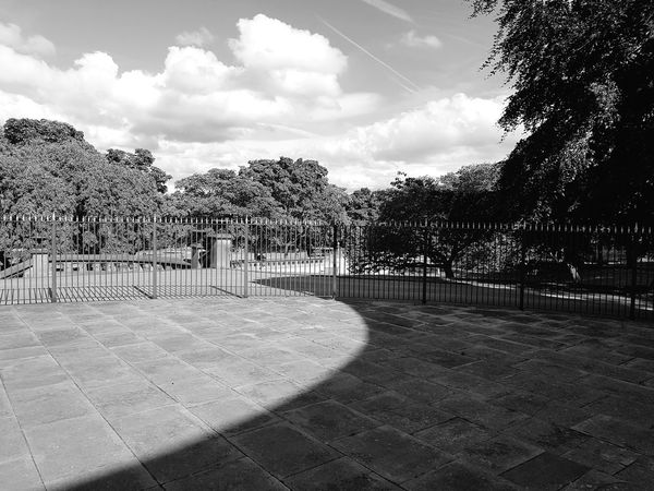Cloud - Sky Tree Sky No People Day Outdoors Huddersfield Park Sunny Day EyeEm Selects Landscape Greenhead Park Sunday Architecture Arched Arches Shadow Black And White Black & White Monochrome Arch Light And Shadow Paving Stones Pavement Fence