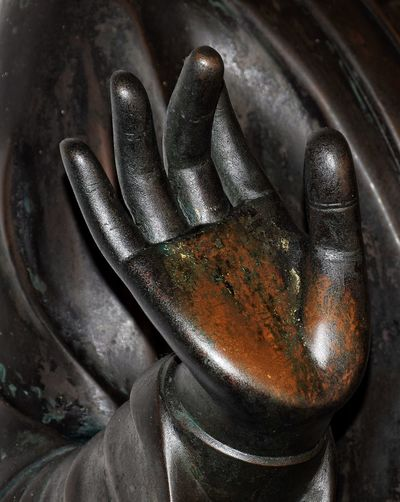 Close-up of old rusty statue