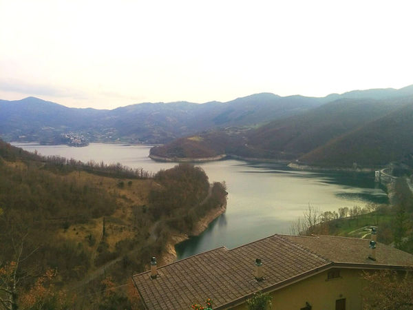 Turano lake, early spring. Architecture Autumn Beauty In Nature Built Structure Calm Day Fall High Angle View Italy Lake Landscape Loneliness Mountain Mountain Range Nature No People Outdoors River Roof Sadness Scenics Sky Turano Turano Lake Water