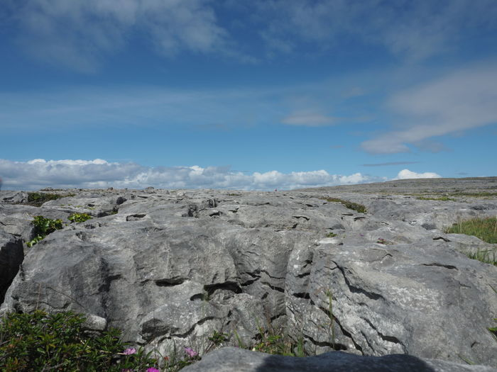 Scenic view of rock against sky