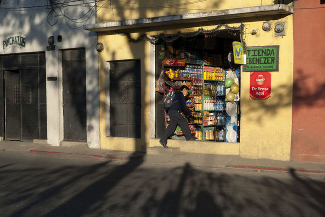 Student rushing into a store Antigua Guatemala City Creative Light And Shadow Deli Food Grocery Guatemala Market Multi Colored Retail  Running Running Child Rush School's Out Shop Store Street Street Photography Student Sunny Sunny Day Tree Urge URGENT Yellow