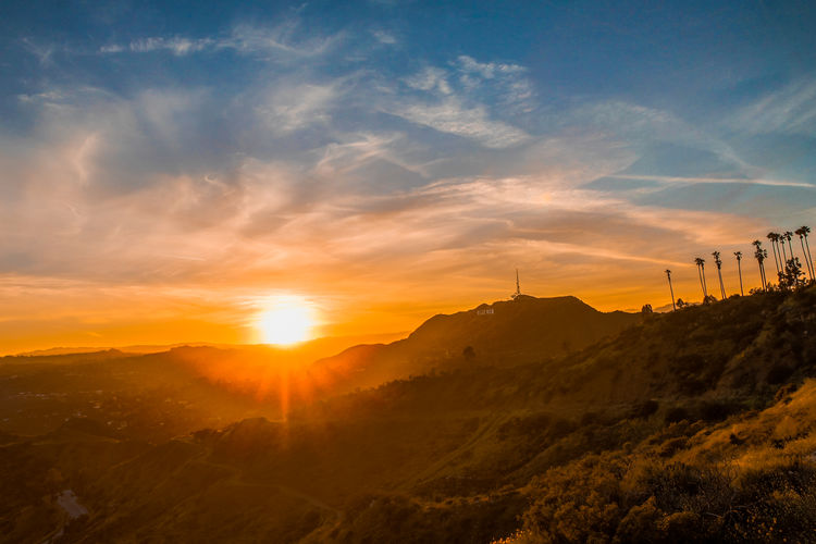 Hollywood Sunset Sky Sunset Cloud - Sky Scenics - Nature Nature Sun Mountain Beauty In Nature Orange Color Landscape Tranquil Scene Environment Tranquility No People Sunlight Architecture Non-urban Scene Built Structure Idyllic Outdoors
