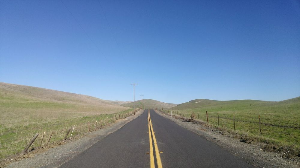 Blue Road Clear Sky The Way Forward Asphalt Landscape Day No People What Who Where Nature Reserve Outdoors Straight Lines Road California Rural Scene Rural Roads Rural Route Nature_collection Hills And Valleys Non-urban Scene Tranquil Scene No People Outdoors Nature Photography Travel Destinations Telephone Poles