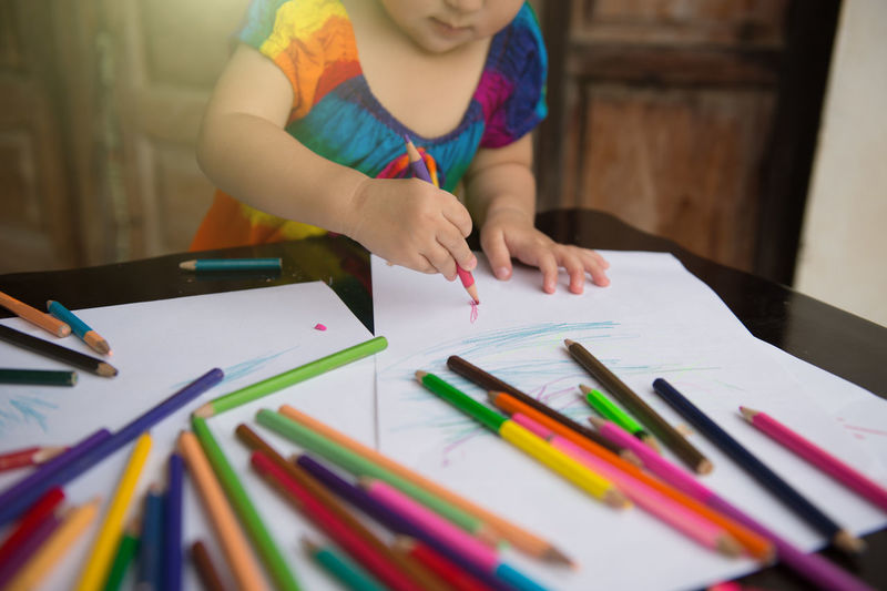 Children learn to draw and paint with various pencil colour and white paper on wooden desk, family relationship concept, home school ArtWork Beautiful Determined To Finish HOME SCHOOLING Imagination Kids Playing Learning Preschool Youth Activity Art And Craft Childhood Colored Pencil Colorful Drawing Education Family Relationship Full Frame Girl Hand Hobby Painting Study Table Various