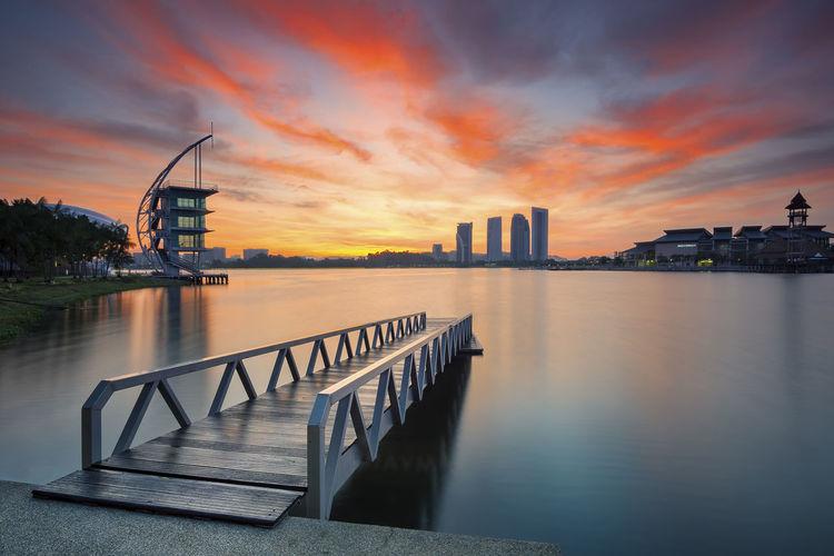 Pier on sea at sunset