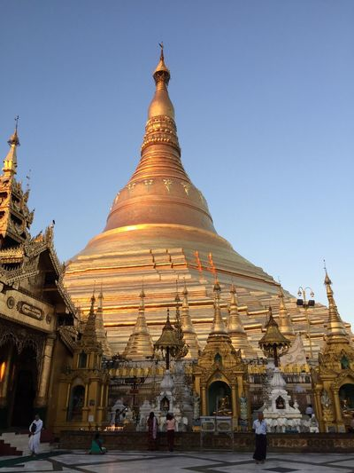 Shwedagon pagoda in Yangon, Myanmar at sunrise Buddhism Pagoda EyeEm Selects Religion Clear Sky Building Exterior Travel Destinations Outdoors Blue Sky