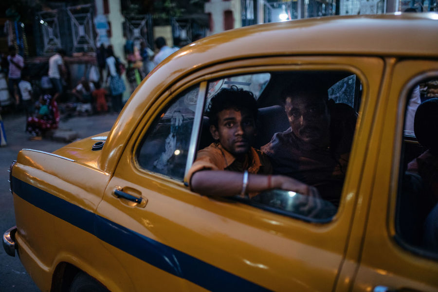 Car Car Door Incredible India India Kolkata Mode Of Transport Taxi The Portraitist - 2017 EyeEm Awards The Street Photographer - 2017 EyeEm Awards Two People Window Yellow Yellow Taxi BYOPaper! BYOPaper! Let's Go. Together. Paint The Town Yellow