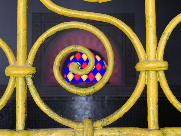 Close-up of multi colored metal railing