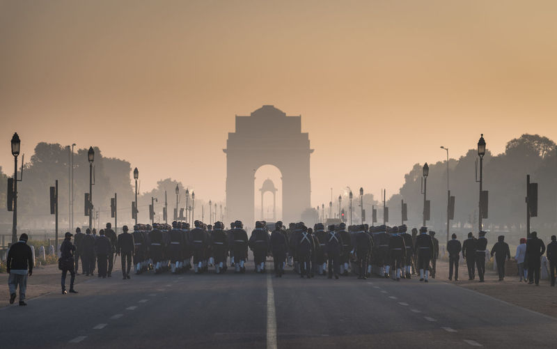 Rear View Of Army Soldiers At India Gate During Sunrise