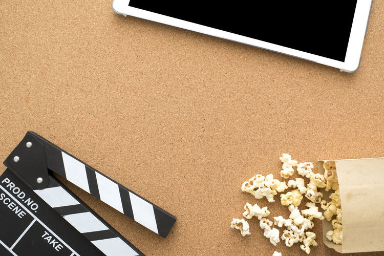 Copy Space Fun MOVIE Popcorn Business Clapperboard Close-up Computer Tablet Crumpled Paper Day Digital Director Download Entertaitn Film Industry Flat Lay Indoors  MOVIE No People On Line Paper Top View Wooden